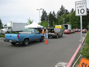 A lineup of cars at the very successful recycling event