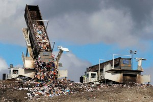 TIPPERS- garbage cascading out of a tipped hauling container