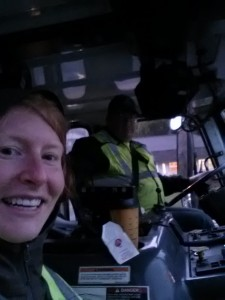 Stephanie and truck driver on the yard waste pickup ridealong