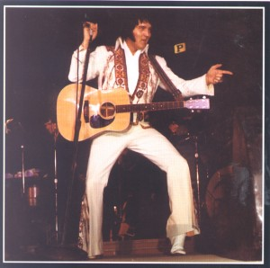 Elvis playing his guitar