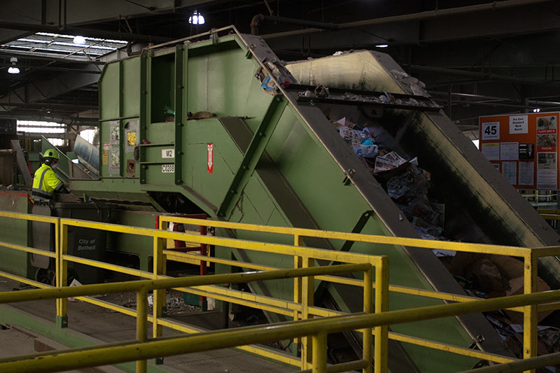 Recyclables on steep conveyor belt at Cascade Recycling Center