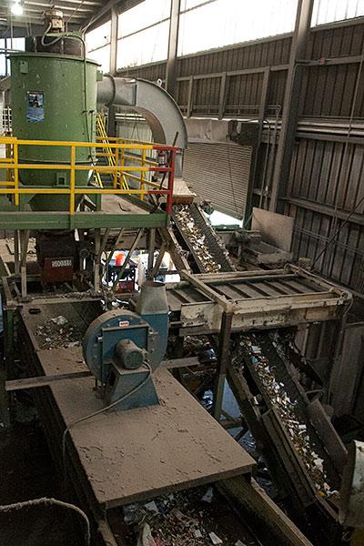 Conveyor belt feeding glass to crusher.