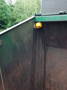 yellow enevo sensor on trash dumpster