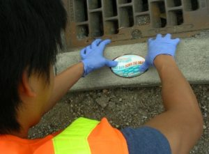 volunteer marking storm drains
