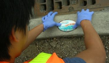 volunteer marking storm drains