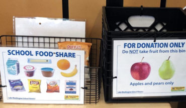 two bins for leftover food at elementary school